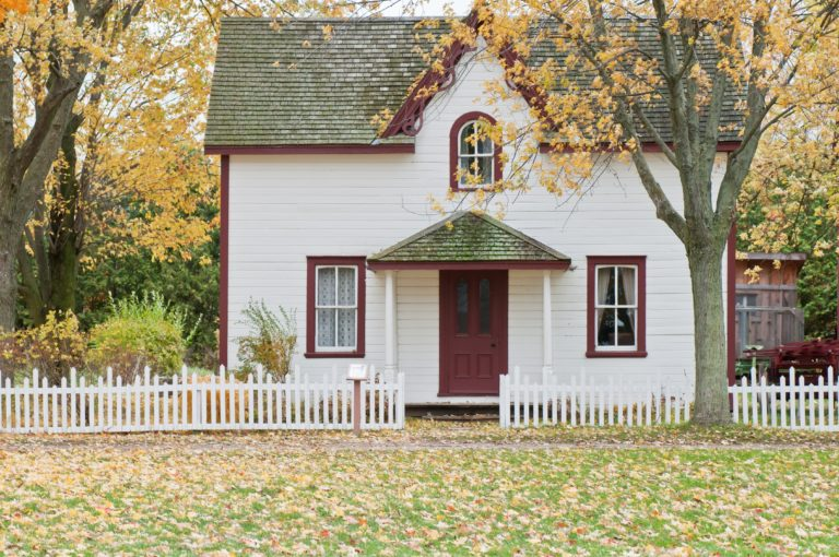 white-house-green-roof-white-picket-fence