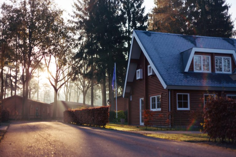 a-red-house-covered-by-high-value-home-insurance